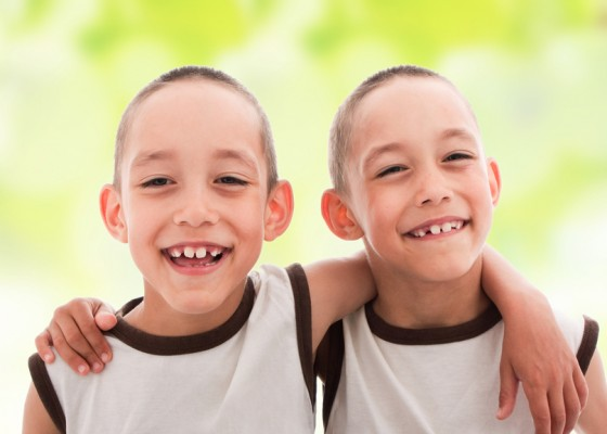 Two smiling happy boys twins